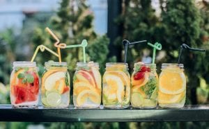 six fruit cocktail jar glasses with straws
