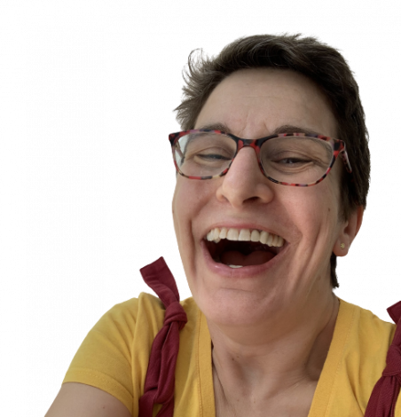 Woman's face with glasses on laughing